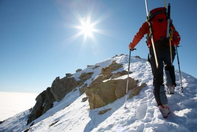 climber summiting snowy peak